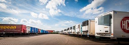 row of  fridge semi trailers