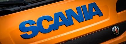Orange blue Scania truck with logo